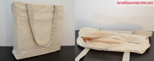 Borsa in tessuto color crema damascato