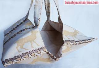 Portatorte in tessuto color crema con renne cuori