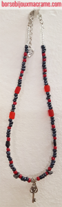 Bijoux _ Collana di perline rosse e antracite e chiave color argento